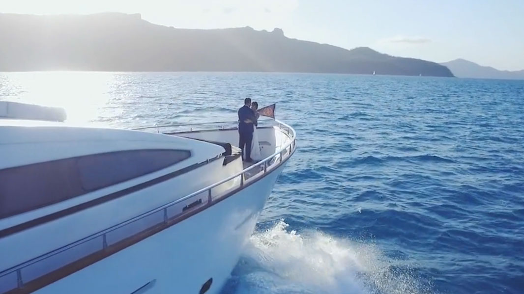 bride and groom on luxury yacht drone