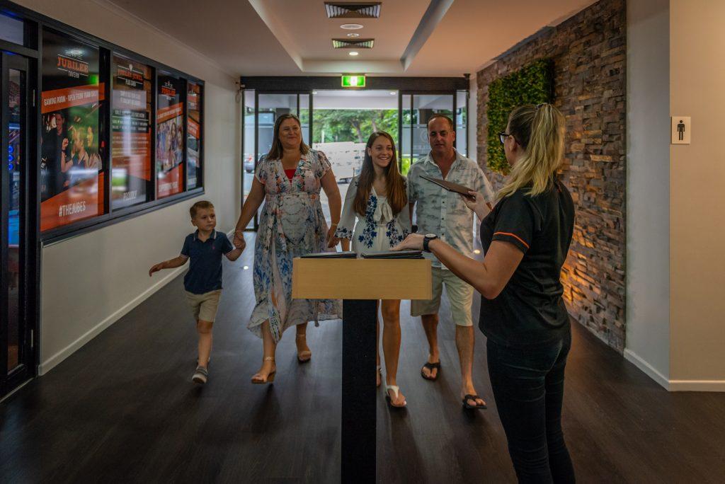 family walking into restaurant