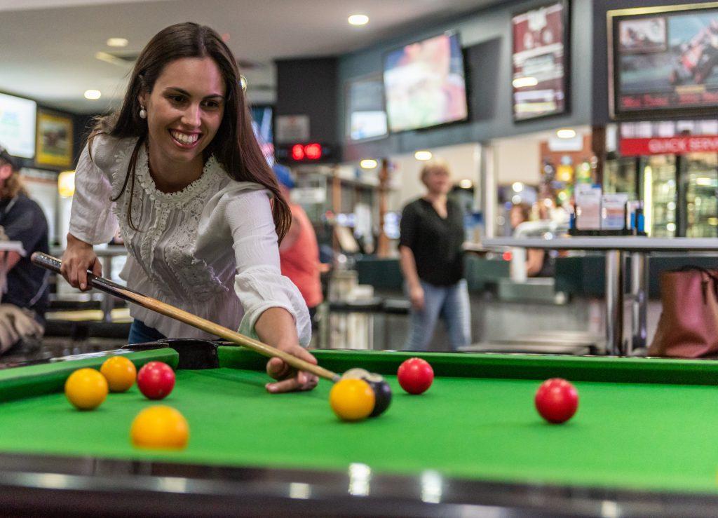 woman playing pool at jubilee tavern