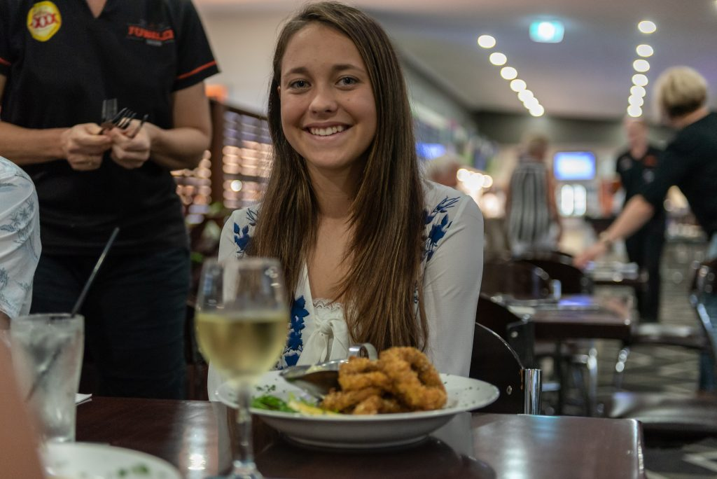 girls with pub dinner meal