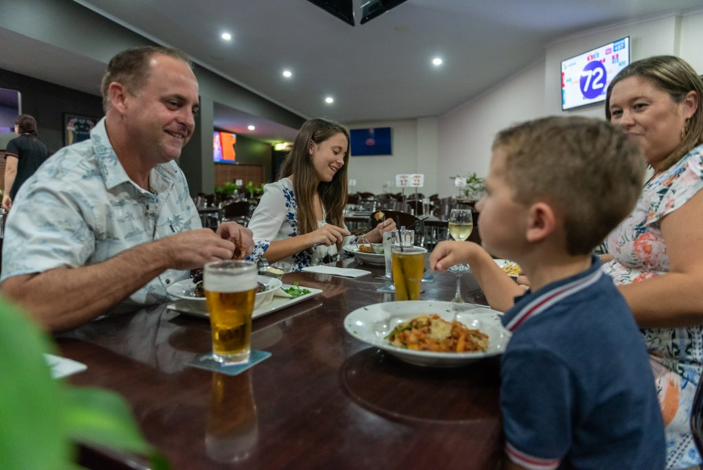 family with pub dinner meal