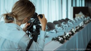videographer filming bridal table