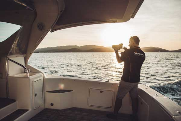 videographer photographer filming from boat