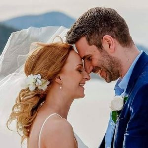 bride and groom smiling touching foreheads