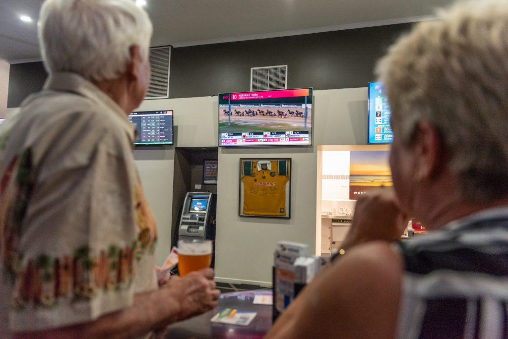 elderly couple placing bets