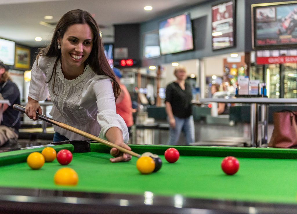 woman playing pool at jubilee tavern